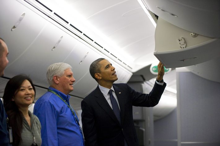 US President Barack Obama looks at the overhead bin in a Boeing 787 Dreamliner that will be delivered to United Airlines during a tour of the production facility prior to speaking on the economy in Everett, Washington, on February 17, 2012.