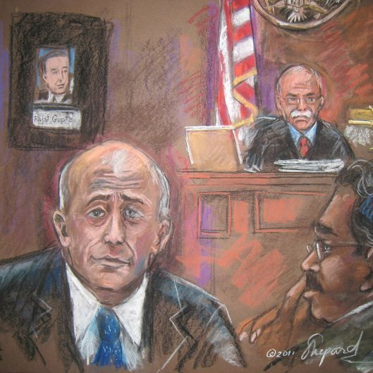 This court room sketch shows US Judge Michael Howell (R rear), with witness Lloyd Blankfein (L) and defendant ex-hedge fund tycoon Raj Rajaratnam on March 23, 2011 in New York. Goldman Sachs boss Lloyd Blankfein took to the stand Wednesday, telling jurors at a high-profile insider trading trial that one of Sachs ex-directors leaked sensitive company secrets. Blankfein admitted former Goldman director Rajat Gupta broke the firm's confidentiality rules by giving on-trial hedge fund manager Rajaratnam an inside take on the bank's possible acquisitions.   AFP PHOTO/SHIRLEY SHEPARD (Photo credit should read SHIRLEY SHEPARD/AFP/Getty Images)