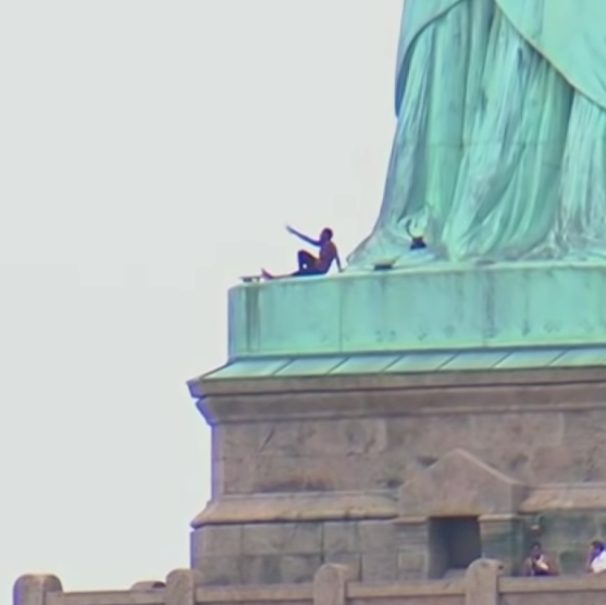 statue of liberty climber protests trump family separations