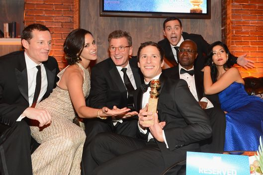 BEVERLY HILLS, CA - JANUARY 12:  COO Fox Broadcasting Joe Earley, actress Melissa Fumero, Fox Chairman of Entertainment Kevin Reilly, actor Andy Samberg, actor Joe Lo Truglio, actor Andre Braugher, and actress Stephanie Beatriz attend the Fox And FX's 2014 Golden Globe Awards Party on January 12, 2014 in Beverly Hills, California.  (Photo by Mark Davis/Getty Images)