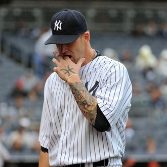 A.J. Burnett #34 of the New York Yankees reacts as he walks back to the dugout after allowing two runs in the top of the third inning against the Baltimore Orioles on September 7, 2011 at Yankee Stadium in the Bronx borough of New York City. (Photo by Christopher Pasatieri/Getty Images)