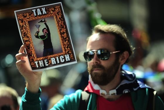 Occupy Wall Street participants take part in a protest to mark the movement's second anniversary in New York, September 17, 2013. Hundreds of Occupy Wall Street participants held a march to mark the movement's anniversary.