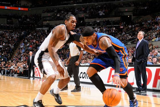 SAN ANTONIO, TX - MARCH 7:   Carmelo Anthony #7 of the New York Knicks drives against Kawhi Leonard #2 of the San Antonio Spurs during the game between the New York Knicks and the San Antonio Spurs at the AT&T Center on March 7, 2012 in San Antonio, Texas. NOTE TO USER: User expressly acknowledges and agrees that, by downloading and or using this photograph, user is consenting to the terms and conditions of the Getty Images License Agreement. Mandatory Copyright Notice: Copyright 2012 NBAE (Photos by D. Clarke Evans/NBAE via Getty Images)