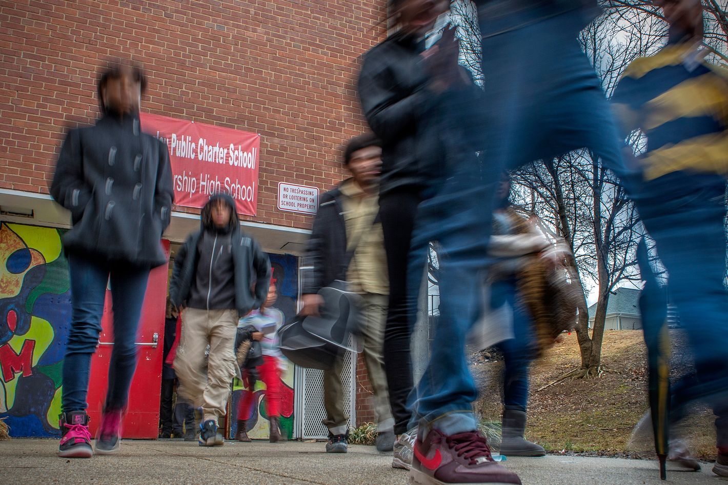 Students file out of the building at quitting time at the Maya Angelou charter school on February, 21, 2014 in Washington, DC.