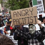 NEW YORK, NY - APRIL 25:  Protesters march to Wall Street during an ACT-UP and Occupy Wall Street demonstration on April 25, 2012 in New York City. ACT-UP (AIDS Coalition to Unleash Power), was marking their 25-year anniversary in supporting services for people with AIDS worldwide. They were joined by Occupy Wall Street protesters in a march from New York's city hall to Wall Street. The groups called for a tax on Wall Street transactions and speculative trades to raise money for to end the global AIDS epidemic and provide universal healthcare in the U.S.  (Photo by John Moore/Getty Images)