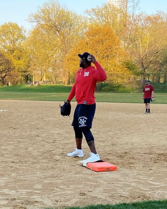 CC Sabathia playing first base in a softball game in Central Park.