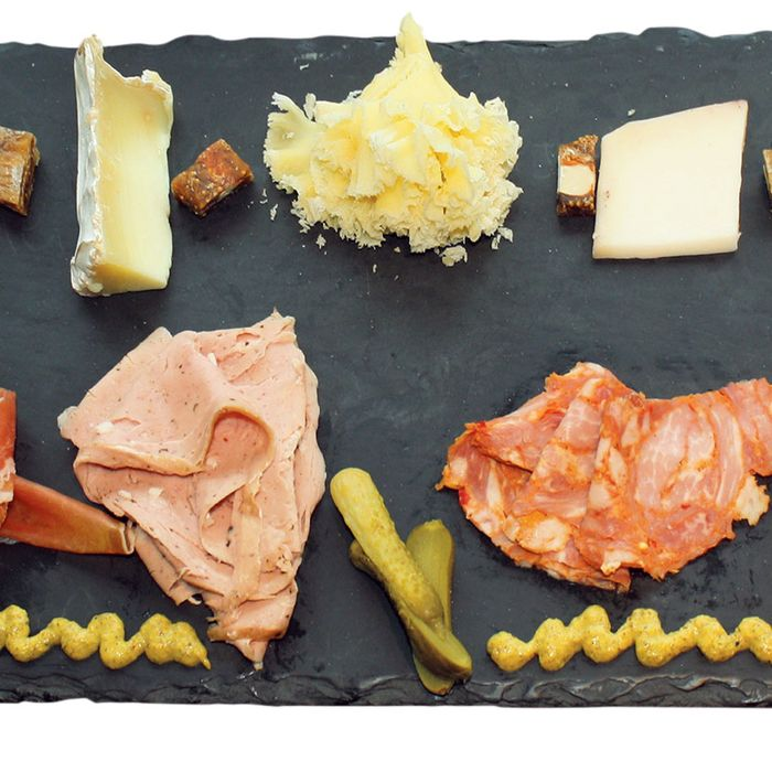 The Works: A combo charcuterie and cheese slate with four artisanal meats and five cheeses.