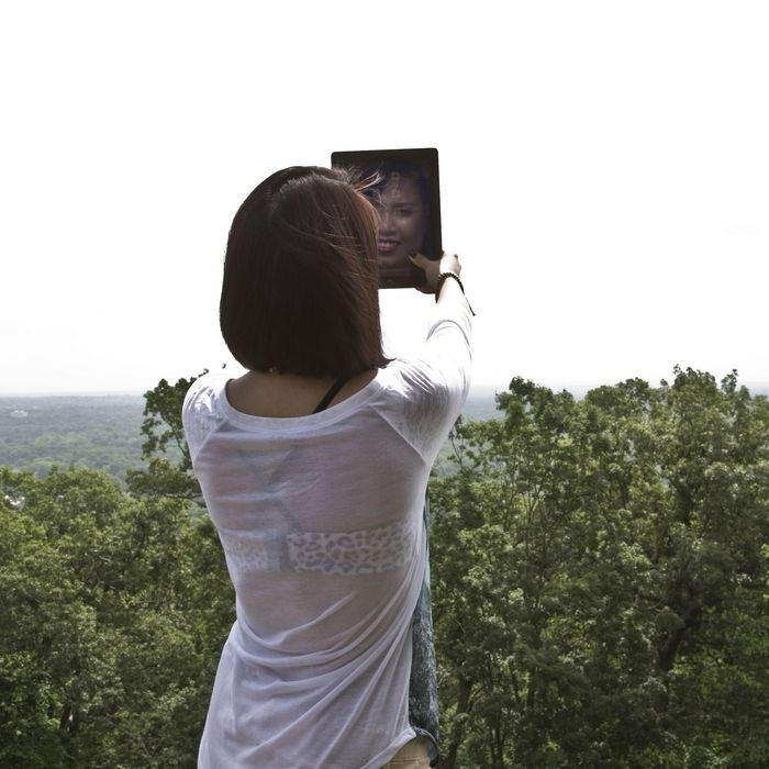 Young woman doing selfie.