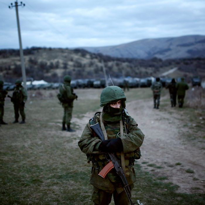 Members of the Russian armed forces stand guard around the Ukrainian military base in the village of Perevalne, 20 km south of Simferopol, on March 2, 2014. Russias armed forces have surrounded Ukraine's troops in the Perevalnoye neighborhood in Ukraine's Autonomous Republic of Crimea, on Sunday. Ukraines military units in Perevalnoye, some 20 km far from Crimeas capital Simferopol, were encircled by more than 200 Russian soldiers. Russia currently has 25 armored vehicles in the region.