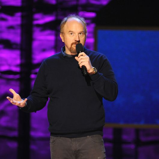 Louis C.K. speaks onstage at Comedy Central's night of too many stars: America comes together for autism programs at The Beacon Theatre on October 13, 2012 in New York City.