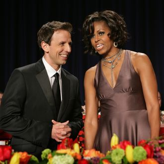 Seth Meyers of Saturday Night Live speaks with First Lady Michelle Obama at the White House Correspondents' Association annual dinner in Washington DC, April 30, 2011. AFP PHOTO / Chris KLEPONIS (Photo credit should read CHRIS KLEPONIS/AFP/Getty Images)