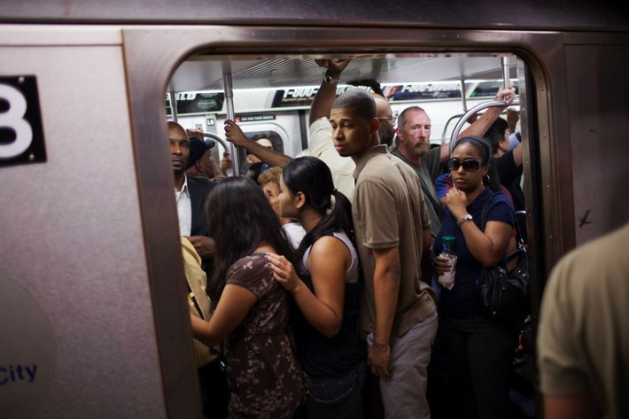 NEW YORK - AUGUST 23: People crowd into a full subway car August 23, 2011 in the Manhattan borough of New York. In 2010, New York's subway system delivered over 1.6 billion rides, averaging 5 million rides on weekdays, over three million on Saturdays and over two million on Sundays. (Photo by Robert Nickelsberg/Getty Images)