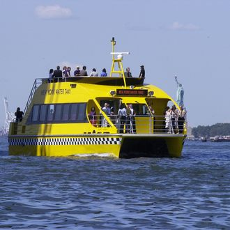 New York Water Taxi catamaran Mickey Murphy on a trial run past the Statue of Liberty.