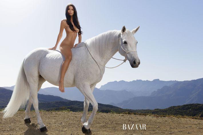 Emily Ratajkowski on a horse