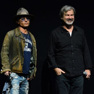 LAS VEGAS, NV - APRIL 17: Actor Johnny Depp (L) and director Gore Verbinski appear at a Walt Disney Studios Motion Pictures presentation to promote their upcoming film