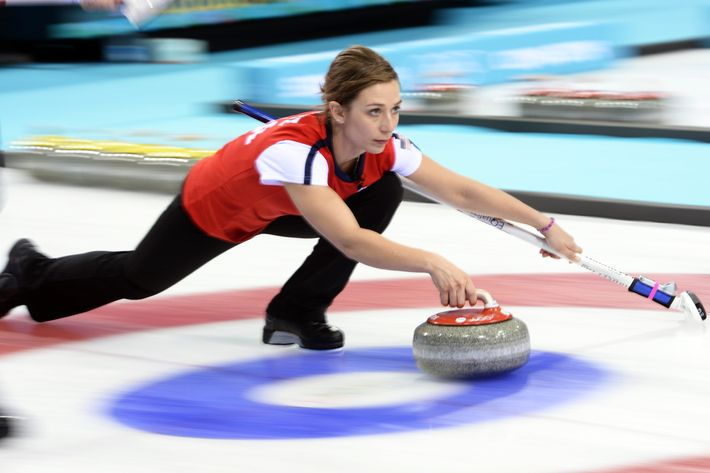 A woman curling.
