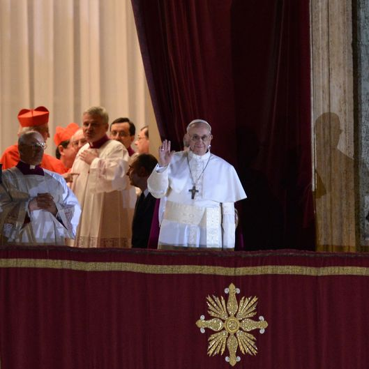 New Pope, Argentinian cardinal Jorge Mario Bergoglio appears at the window of St Peter's Basilica's balcony after being elected the 266th pope of the Roman Catholic Church on March 13, 2013 at the Vatican.