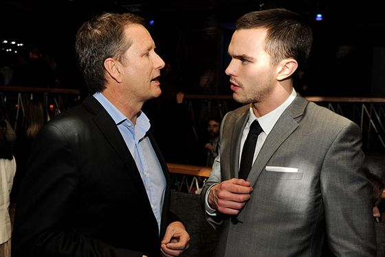 "LOS ANGELES, CA - JANUARY 29:  Michael Burns (L), Vice Chairman, Lionsgate and actor Nicholas Hoult pose at the after party for the premiere of Summit Entertainment's ""Warm Bodies"" at The Colony on January 29, 2013 in Los Angeles, California.  (Photo by Kevin Winter/Getty Images)"