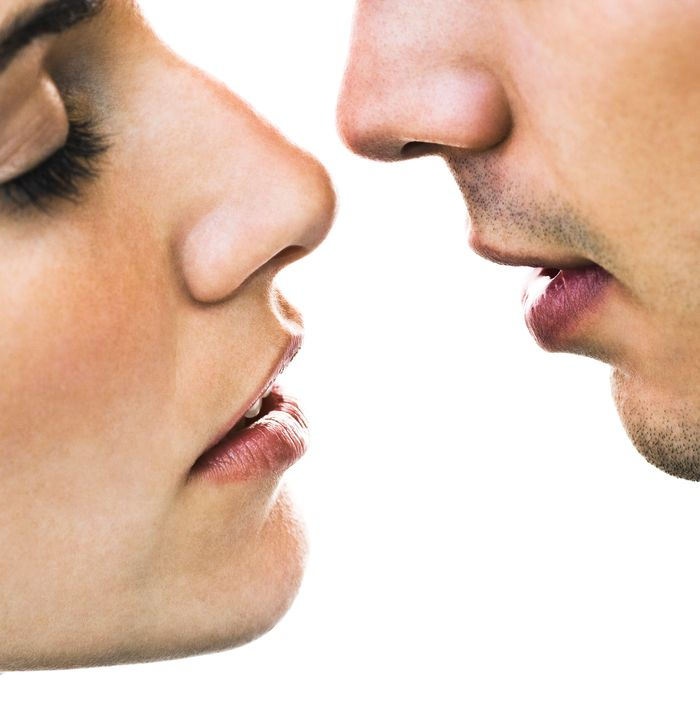 Man and woman, about to kiss.