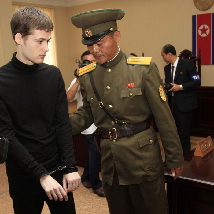Handcuffed Matthew Miller, a U.S. citizen, leaves after his trial at the Supreme Court in Pyongyang, North Korea, Sunday, Sept. 14, 2014. North Korea's Supreme Court on Sunday sentenced Miller to six years of hard labor for entering the country illegally and trying to commit espionage. (AP Photo/Kim Kwang Hyon)