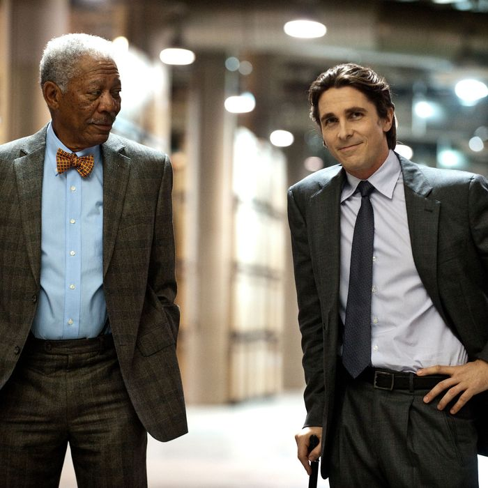"L-r: MORGAN FREEMAN as Lucius Fox and CHRISTIAN BALE as Bruce Wayne in Warner Bros. Pictures' and Legendary Pictures' action thriller ""THE DARK KNIGHT RISES"""