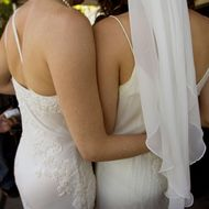 Two women embrace after getting married at city hall in San Francisco, California.
