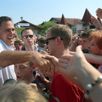 FRANKENMUTH, MI - JUNE 19: Republican presidential candidate, former Massachusetts Gov. Mitt Romney shakes hands with people during a campaign event in front of the Bavarian Inn Lodge on June 19, 2012 in Frankenmuth, Michigan. Mr. Romney is on the last day of a five day bus trip through battle ground states as he battles President Barack Obama for votes. (Photo by Joe Raedle/Getty Images)