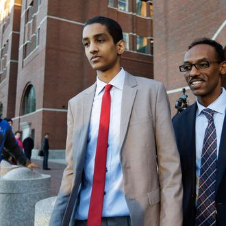 Robel Phillipos, center, a college friend of Boston Marathon?bombing suspect Dzhokhar Tsarnaev, departs federal court with defense attorney Derege Demissie, right, following jury deliberations in his trial, Monday, Oct. 27, 2014, in Boston. Phillipos is accused of lying about being in Tsarnaev's dorm room three days after the deadly bombing, when two other friends removed a backpack containing fireworks and other potential evidence. (AP Photo/Steven Senne)