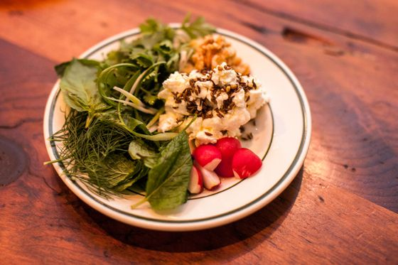 Lakh Lakh's fresh herb platter with radishes, walnuts, and spiced feta cheese.