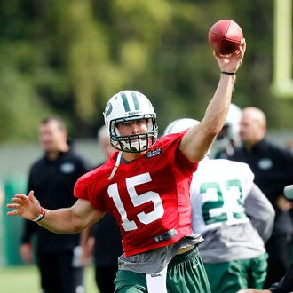 Tim Tebow #15 of the New York Jets works out at Jets Training Camp at SUNY Cortland on July 27, 2012 in Cortland, New York.