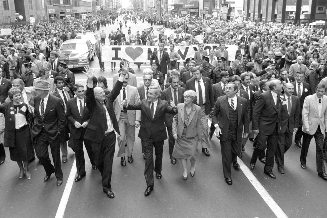 10/8/1984-New York, NY: Walking up Fifth Avenue 10/8 in the Columbus Day Parade are (left to right): Governor Mario Cuomo, Democratic Presidential Candidate Walter Mondale (c), his Vice-Presidential running mate Geraldine Ferraro and New York Governor Mario Cuomo.