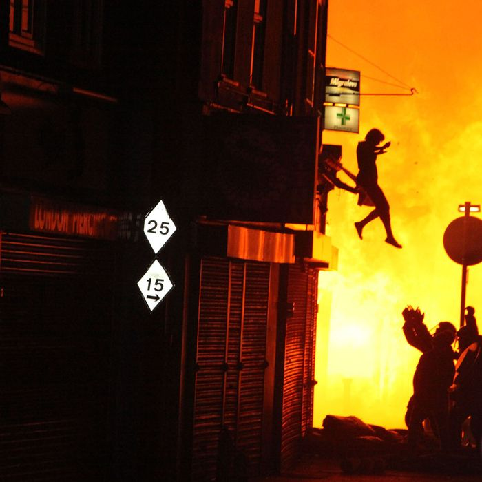 A woman can be seen jumping from a burning building in Surrey Street after rioting took place in Croydon, England on August 8, 2011. Riots and looting have broken out all across Greater London and are now spreading across the country following the shooting of Mark Duggan by police in Tottenham, North London on Friday, August 8th London, England - 08.08.11 Mandatory Credit: WENN.com