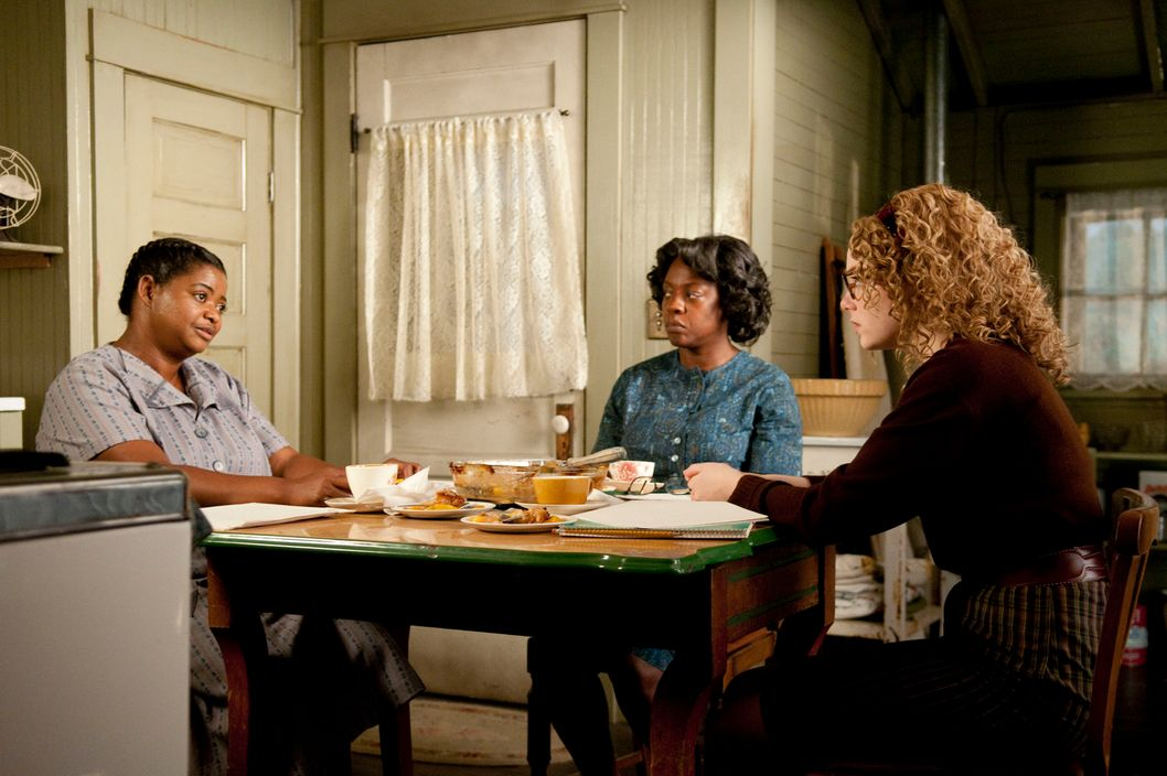 """THE HELP""  TH-006  In Jackson, Mississippi in 1963, Minny Jackson (Octavia Spencer, left), Aibileen Clark (Academy Award? nominee Viola Davis, center) and Skeeter Phelan (Emma Stone, right) form an improbable alliance, resulting in a remarkable sisterhood that instills all of them with the courage to transcend the lines that define them, in DreamWorks Pictures' inspiring drama, ""The Help,"" based on the New York Times best-selling novel by Kathryn Stockett. ""The Help"" is written for the screen and directed by Tate Taylor, with Brunson Green, Chris Columbus and Michael Barnathan producing.  Ph: Dale Robinette  ?DreamWorks II Distribution Co., LLC. ?All Rights Reserved."