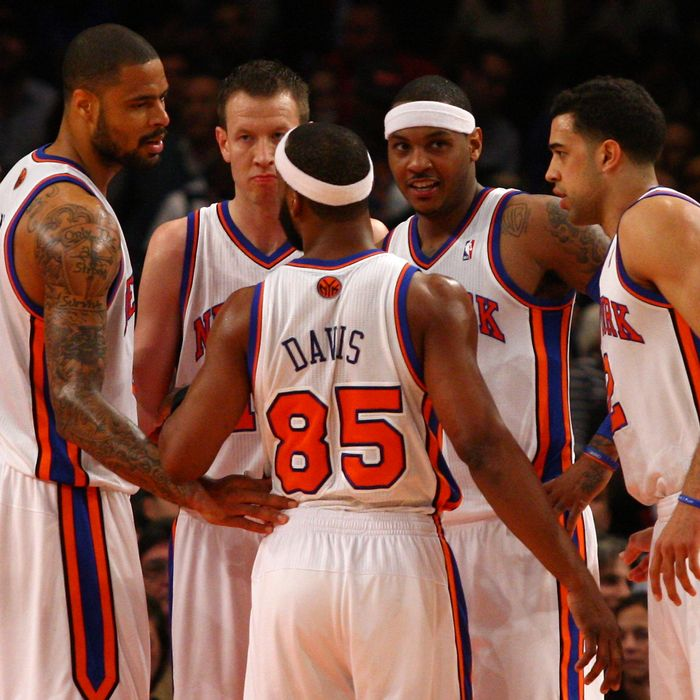 (L-R) Tyson Chandler, Steve Novak #16, Baron Davis #85, Carmelo Anthony #7 and Landry Fields #2 of the New York Knicks at Madison Square Garden on March 26, 2012 in New York City.