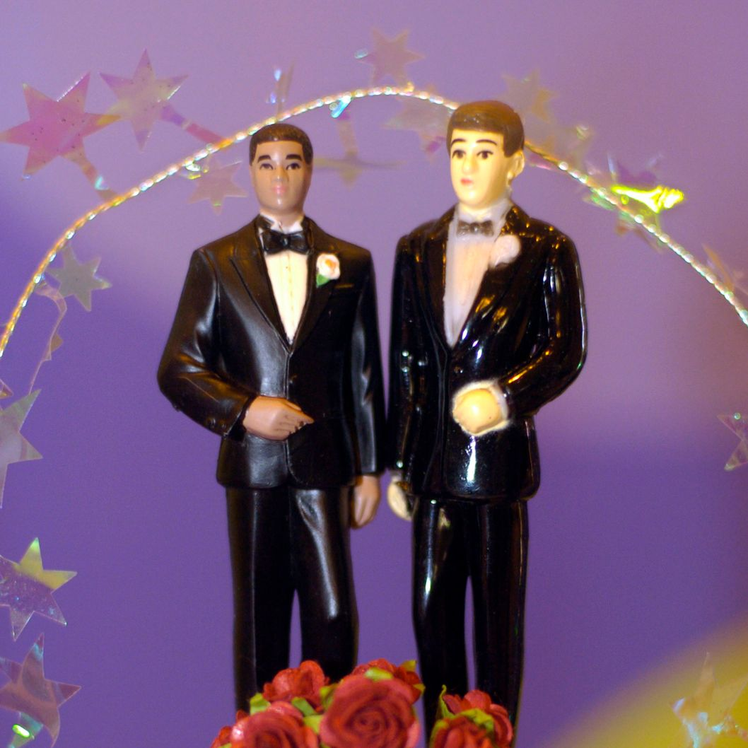 A wedding cake decoration featuring two men created by ZippyDogs, a promotional business, is on display at the Gay Wedding Show on April 17, 2004 in Seattle, Washington