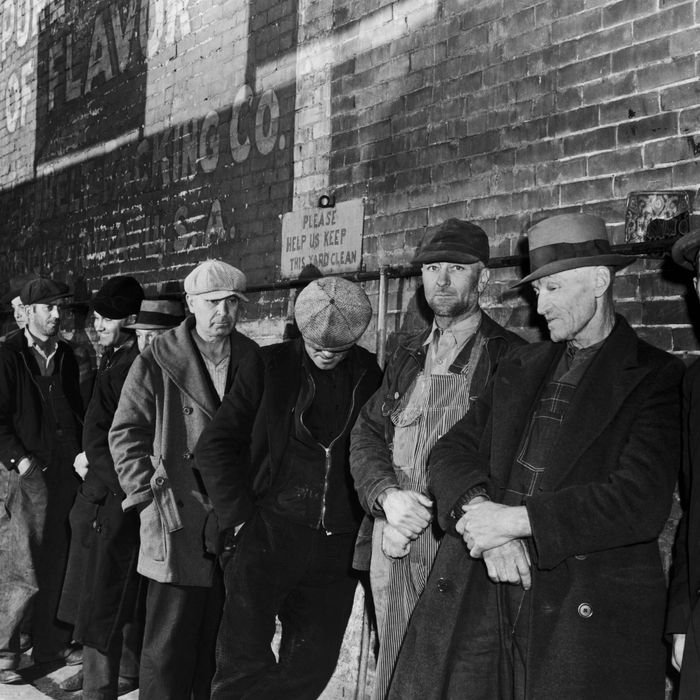 Unemployed men queuing for food during the Great Depression, Iowa, USA, circa 1935. (Photo by FPG/Hulton Archive/Getty Images)