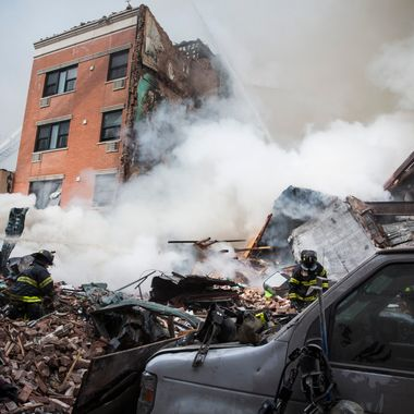 NEW YORK, NY - MARCH 12:  Heavy smoke pours from the debris as the Fire Department of New York (FDNY) responds to a 5-alarm fire and building collapse at 1646 Park Ave in the Harlem neighborhood of Manhattan March 12, 2014 in New York City. Reports of an explosion were heard before the collapse of two multiple-dwelling buildings that left at least 11 injured.  (Photo by Andrew Burton/Getty Images)