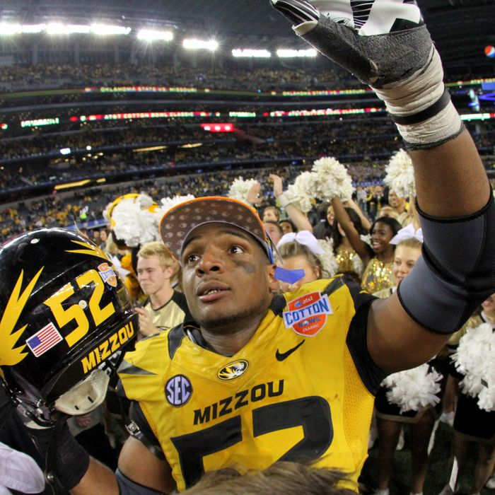 3 January 2014 - Missouri Tigers defensive end Michael Sam (#52) celebrates after the AT&T Cotton Bowl Classic matchup between the Missouri Tigers and Oklahoma State Cowboys at AT&T Stadium in Arlington, Texas. Missouri won the game 41-31.