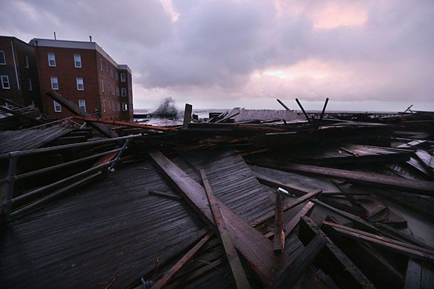 ATLANTIC CITY, NJ - OCTOBER 30:   Sections of an old boardwalk are seen destroyed by flooding from Hurricane Sandy on October 30, 2012 in Atlantic City, New Jersey. The storm has claimed at least 16 lives in the United States, and has caused massive flooding across much of the Atlantic seaboard. US President Barack Obama has declared the situation a 'major disaster' for large areas of the US East Coast including New York City. (Photo by Mario Tama/Getty Images)