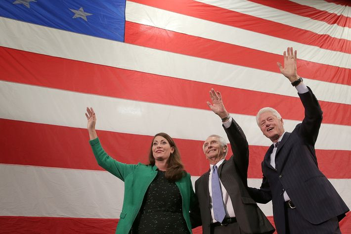 Former U.S. President Bill Clinton (R) campaigns for U.S. Senate Democratic candidate and Kentucky Secretary of State Alison Lundergan Grimes (L) with Kentucky Gov. Steve Beshear (C) during a rally October 21, 2014 in Paducah, Kentucky. Grimes remains locked in a tight race with Senate Minority Leader Mitch McConnell (R-KY) with midterm elections less than two weeks away.