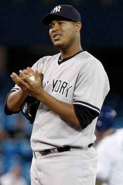 Ivan Nova #47 of the New York Yankees reacts after giving up a two-run home run to Brett Lawrie of the Toronto Blue Jays during MLB action at the Rogers Centre September 27, 2012 in Toronto, Ontario, Canada.