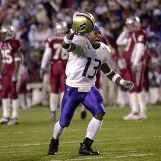 Nate Robinson of the Washington Huskies celebrates after defeating the Washington State Cougars 29-26 in triple overtime on November 23, 2002.