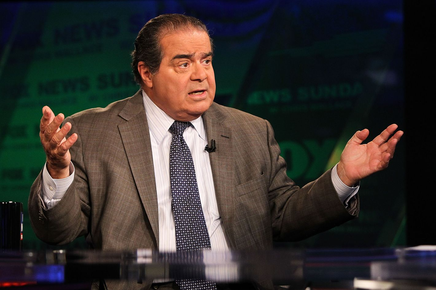 "U.S. Supreme Court Justice Antonin Scalia takes part in an interview with Chris Wallace on  ""FOX News Sunday"" at the FOX News D.C. Bureau on July 27, 2012 in Washington, DC."