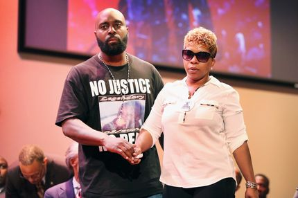 FERGUSON, MO - AUGUST 17:  Michael Brown Sr. and Lesley McSpadden, the parents of slain teenager Michael Brown, attend a rally at Greater Grace Church on August 17, 2014 in Ferguson, Missouri. Their son was shot and killed by a Ferguson police officer on August 9. Despite the Brown family's continued call for peaceful demonstrations, violent protests have erupted nearly every night in Ferguson since his death.  (Photo by Scott Olson/Getty Images)