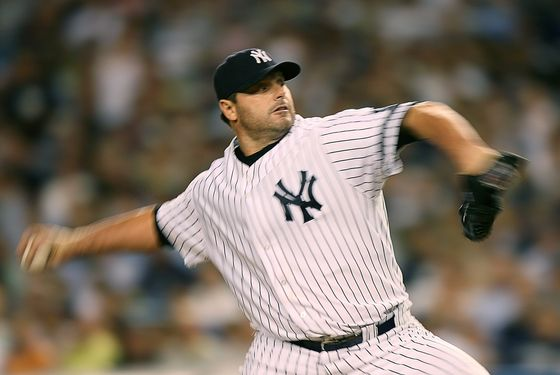 NEW YORK - AUGUST 29:  Pitcher Roger Clemens #22 of the New York Yankees pitches during a game against the Boston Red Sox on August 29, 2007 at Yankee Stadium in the Bronx borough of New York City.  (Photo by Mike Ehrmann/Getty Images) *** Local Caption *** Roger Clemens