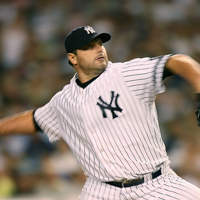 Pitcher Roger Clemens #22 of the New York Yankees pitches during a game against the Boston Red Sox on August 29, 2007 at Yankee Stadium in the Bronx borough of New York City.