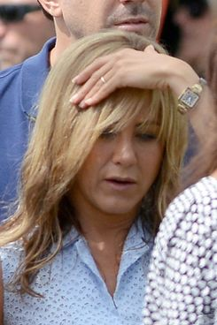 "Newly engaged star Jennifer Aniston shows off her engagement ring on the set of her new film ""We're the Millers"" on August 20, 2012 in Wilmington, North Carolina."