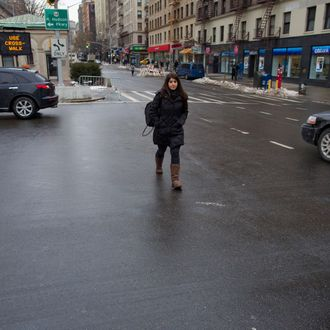 A Pedestrian walks outside of a crosswalk at the busy intersection of W. 96th Street and Broadway in the Upper West Side of New York Monday, Jan. 27, 2014.