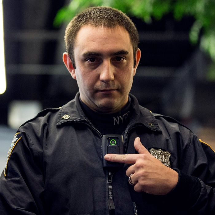 New York Police Department (NYPD) Officer Joshua Jones demonstrates how to use and operate a body camera during a press conference on December 3, 2014 in New York City. The NYPD is beginning a trial exploring the use of body cameras; starting Friday NYPD officers in three different precincts will begin wearing body cameras during their patrols.