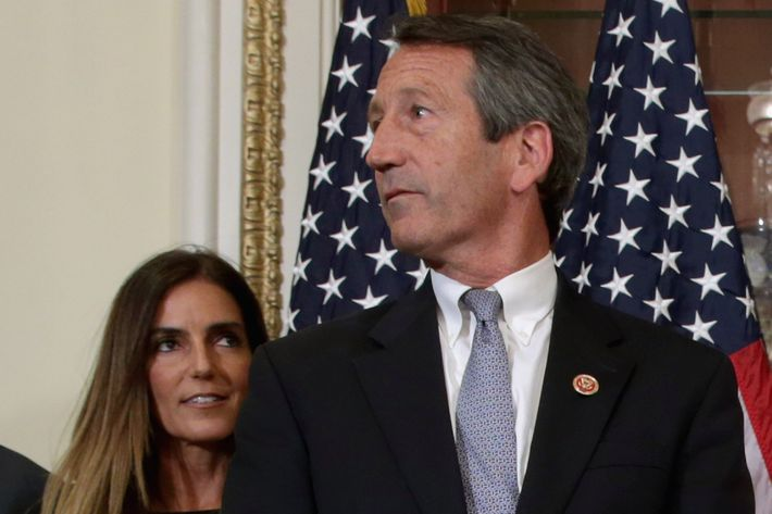 WASHINGTON, DC - MAY 15: U.S. Rep. Mark Sanford (R-SC) (R) and his fiance Maria Belen Chapur wait for Speaker of the House John Boehner (R-OH) for a ceremonial swearing-in at the U.S. Capitol May 15, 2013 in Washington, DC. The former governor of South Carolina, Sanford won a special election on May 7 to win the seat vacated by Republican Tim Scott, who was appointed to the Senate. Sanford has returned to politics after his public service career was derailed in 2009 by an extramarital affair with Chapur that cost him his marriage. (Photo by Chip Somodevilla/Getty Images)